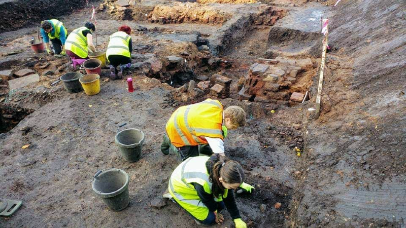 Ella in Trench 6 where she brought up the bronze hairpin with her Homebase trowel. Behind, square pilae tiles supported the roof of the hypocaust    © Dave Brooks at Carlisle Roman Bathhouse