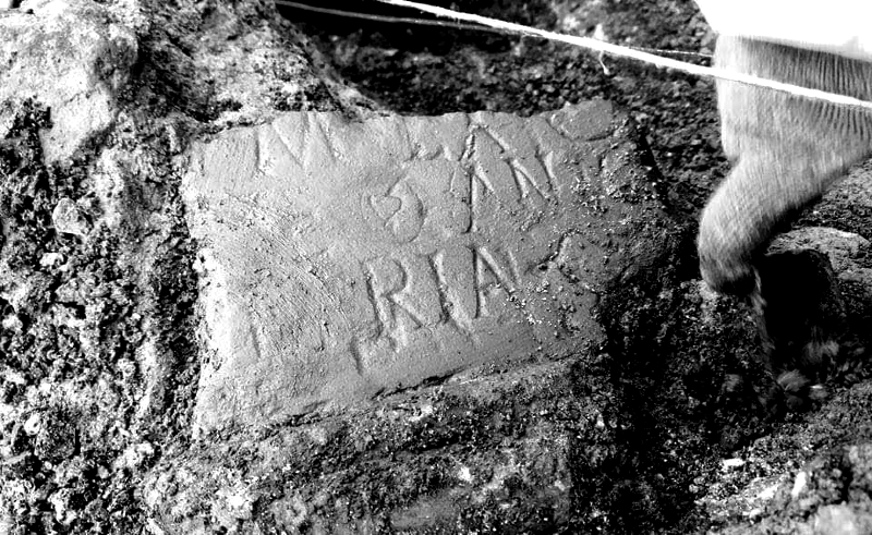 A tombstone to a fallen soldier emerges from Trench 5   © Dave Brooks